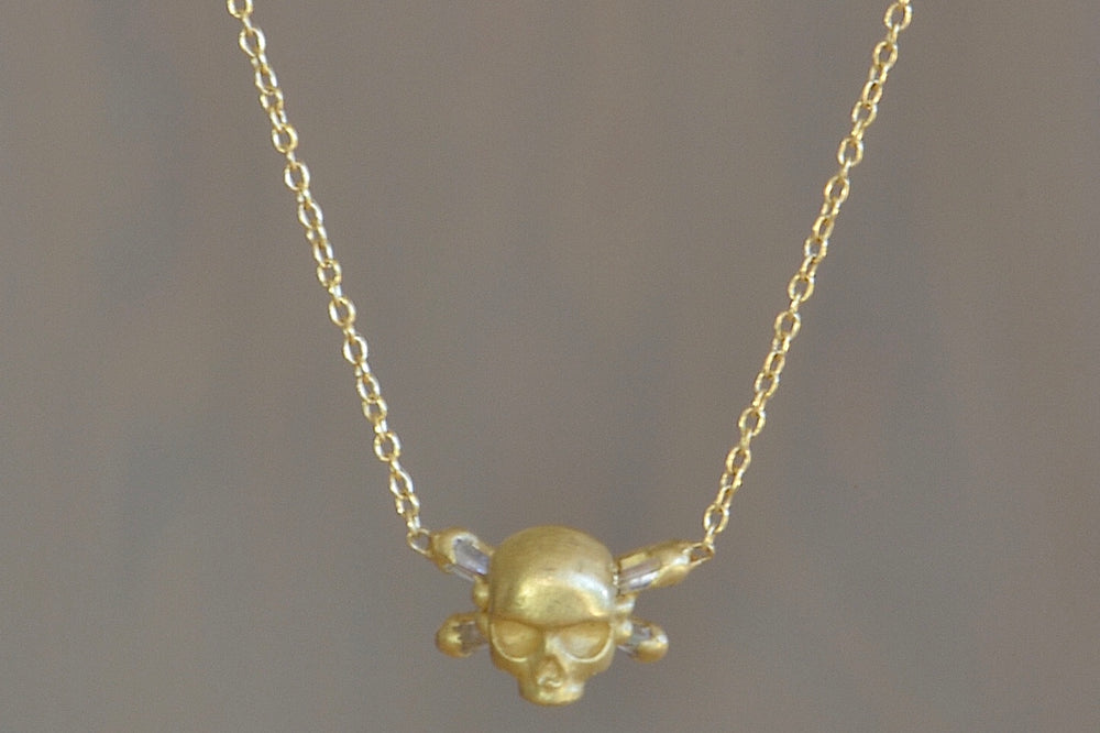 Small Skull & Bone Necklace with Baguette Diamonds