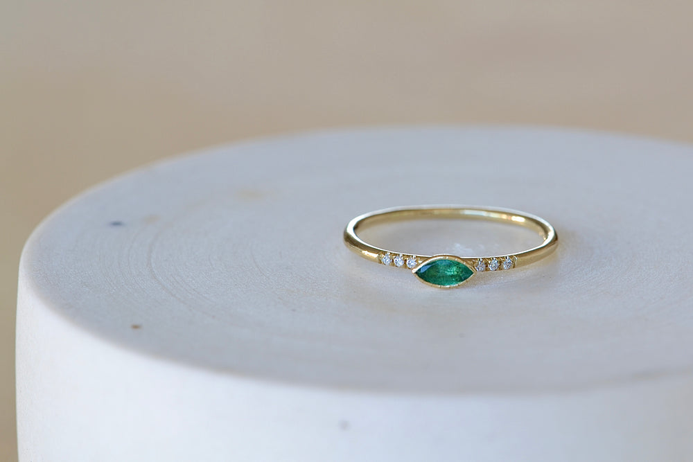 Load image into Gallery viewer, Jennie Kwon Emerald Marquise Equilibrium Point Ring six diamonds round 14k yellow band milgrain engraved detail bezel set