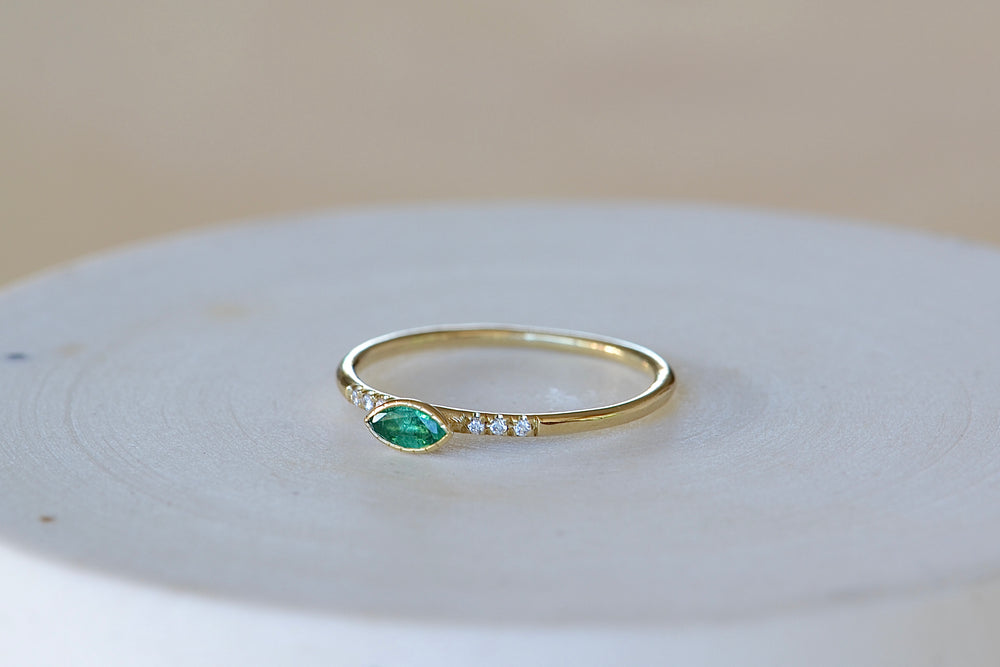Jennie Kwon Emerald Marquise Equilibrium Point Ring six diamonds round 14k yellow band milgrain engraved detail bezel set