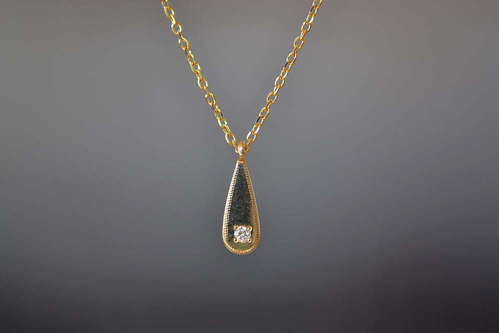 Jennie Kwon Teardrop Diamond Mirror Pendant Necklace Milgrain detail 1 one diamond 14k yellow gold chain classic dainty layering statement