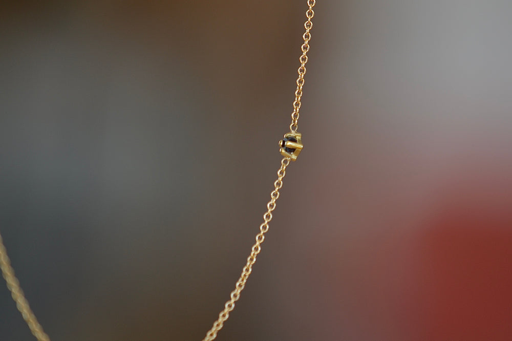 Lizzie Mandler Prong Set Black Diamond Floating Princess Necklace in 18k yellow gold.
