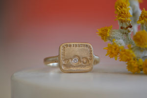 Makiko Wakita Join or Die Motto Signet Ring rectangular face heart arrow white diamond matte satin finish 14k yellow gold 2mm band