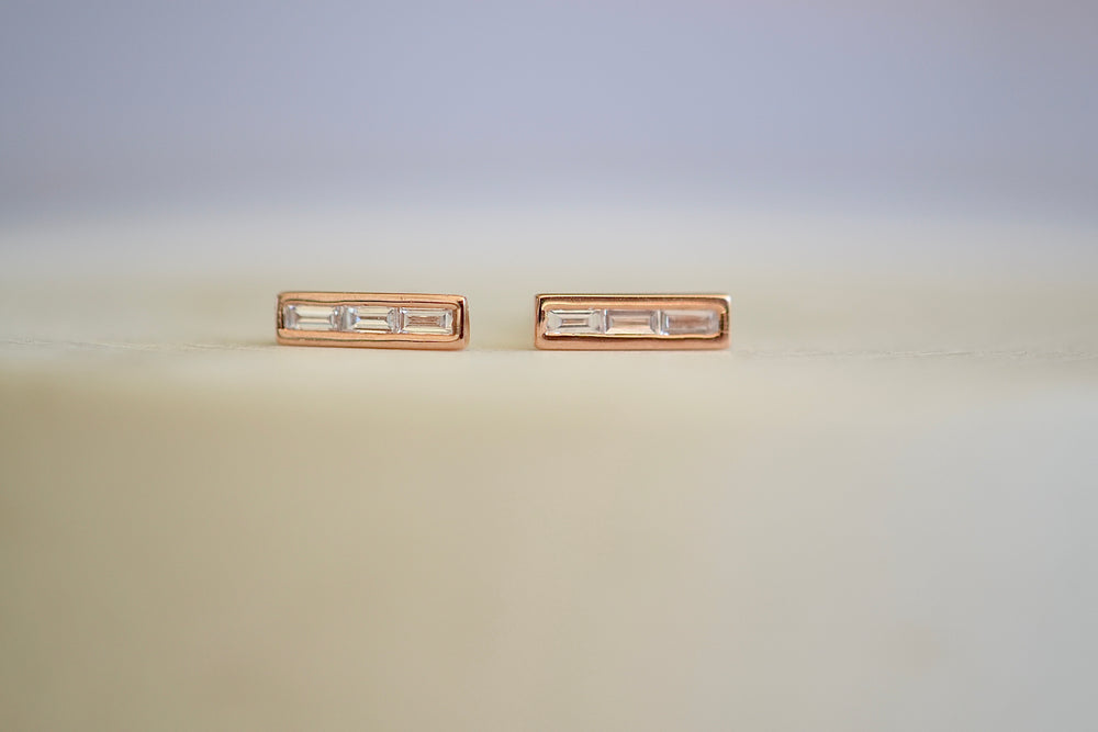 Three 3 white diamond baguettes bezel set in 14k rose gold