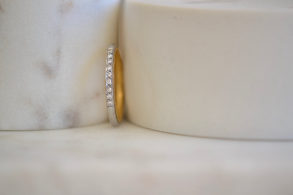 Malcolm Betts Thin 1.8 mm hammered platinum band with 22k yellow gold interior and  9 nine channel set white diamonds pave