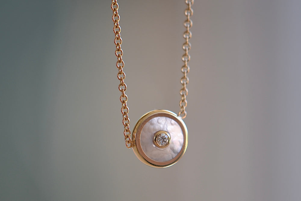 "Load image into Gallery viewer, Retrouvai Mini Compass Pendant Dark Mother of Pearl white Diamond accent 14k yellow gold 16"" chain"