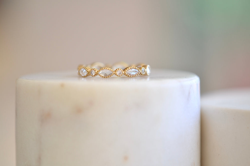 Sethi Couture Amara bow band with alternating marquise marquis rose cuts and round brilliant cut white diamonds in 18k yellow gold bezel with milgrain detail