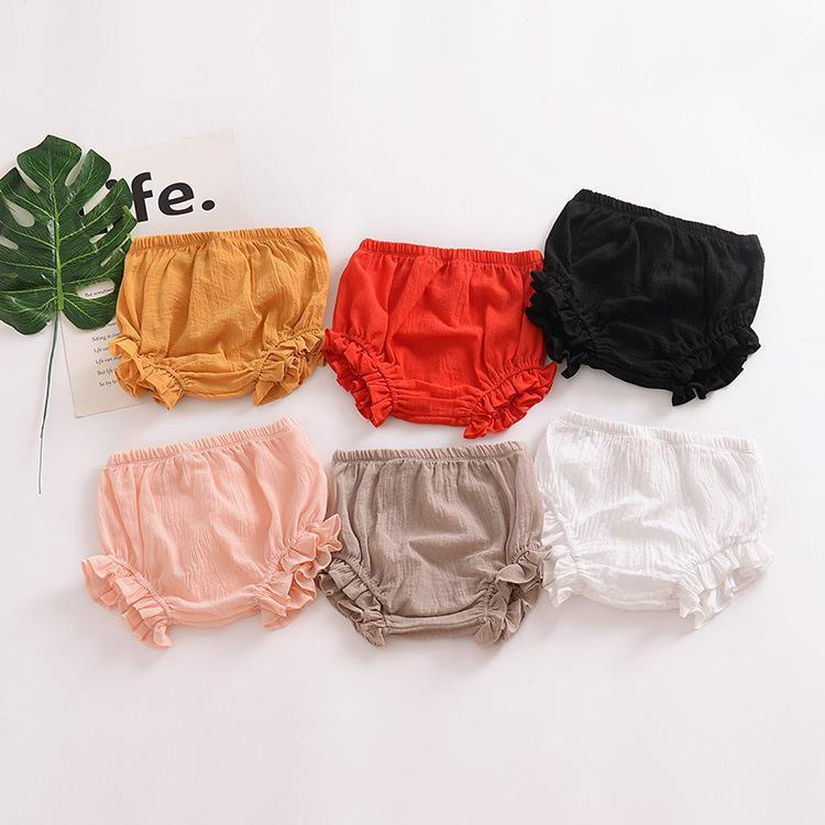 Pure color cotton and linen lace triangle leisure big PP baby shorts bread pants