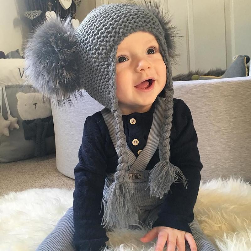 Children raccoon fur cap with two balls to protect ears and twist braid knitted warm wool hat boy and girl baby