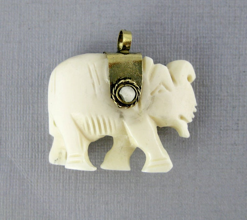 Elephant Pendant-- White Carved Bone Elephant with Gold Toned Cap and White Gemstone Accents Reversible Pendant (S54B4-04)