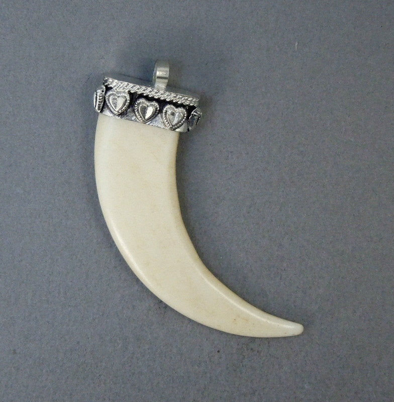 Tibetan White Carved Bone Horn Pendant with Silver Tone Cap and Hearts