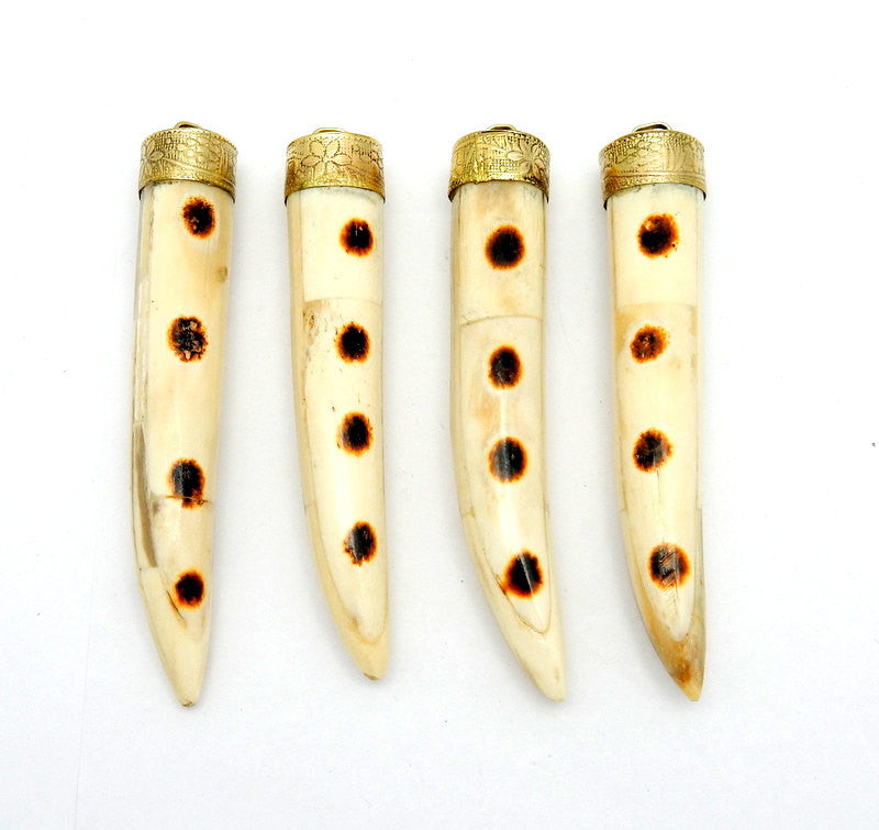 Tibetan-style White Carved Horn Pendant With Brown Dot Accents and Brass Cap.