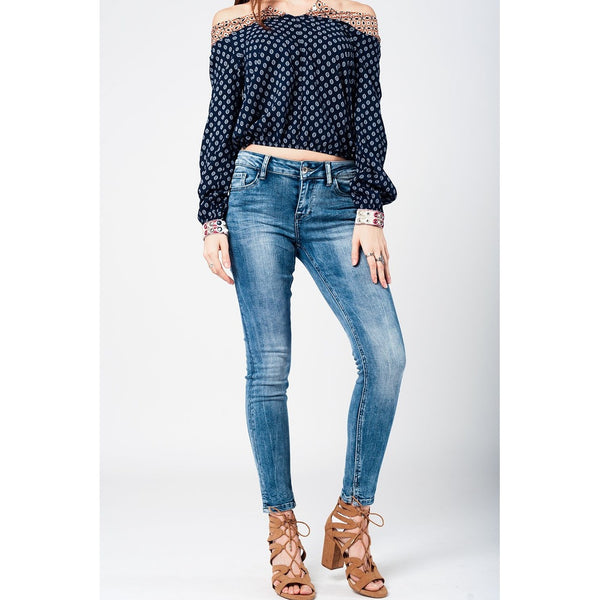 Skinny jeans in mid blue with side split hem - Epethiya