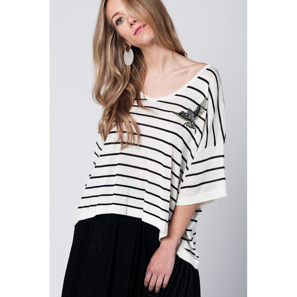 White sweater with black stripes and bird detail on the front - Epethiya