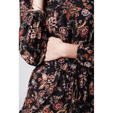 Short long-sleeved jumpsuit with floral print