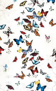 A LARGE WALL ART PIECE OF AN ARRAY OF COLORFUL BUTTERFLIES TO BRIGHTEN YOUR SPACE