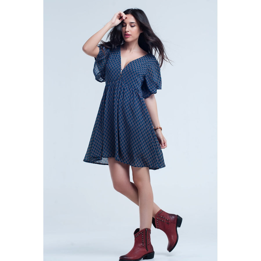 Blue dress with flight and geometric pattern