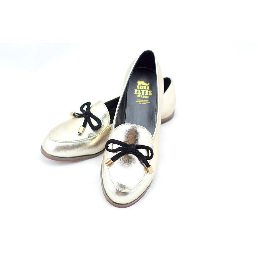 Oscar gold with a feminine bow loafers