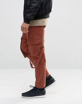 Drop Crotch Cropped Trousers With Cargo Pockets In Rust