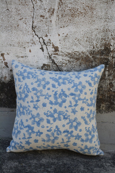 Dull blue printed cushion cover.
