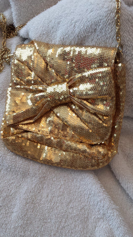 Tomiko - golden sequins evening bag with big bow on the front