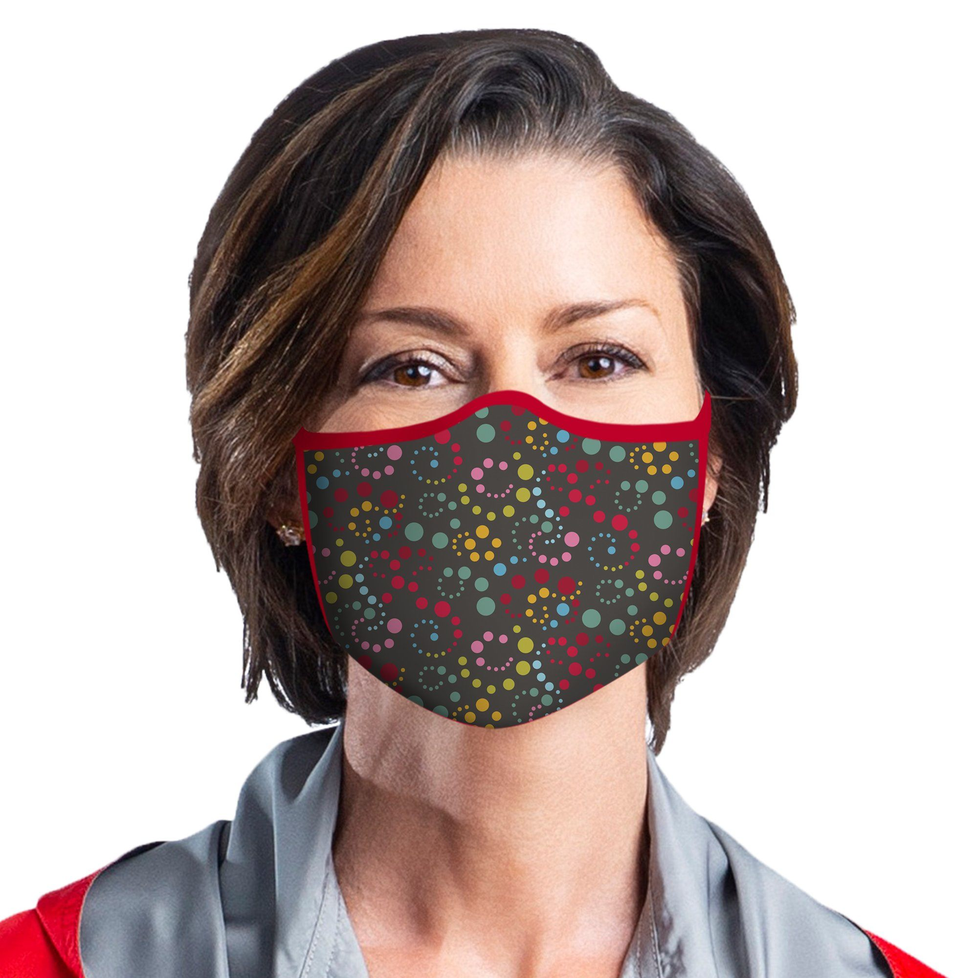Woman wearing a RainCaper Swirl Dots Reusable Fabric Face Mask.