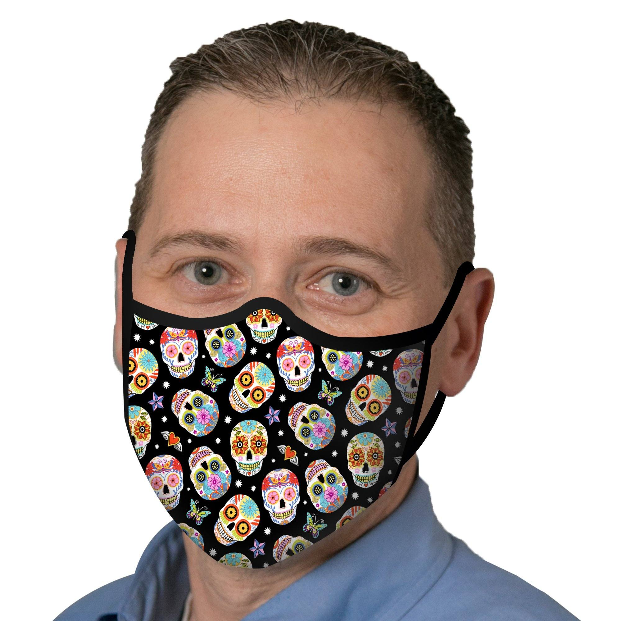 Man wearing a RainCaper Sugar Skulls Print Reusable Fabric Face Mask