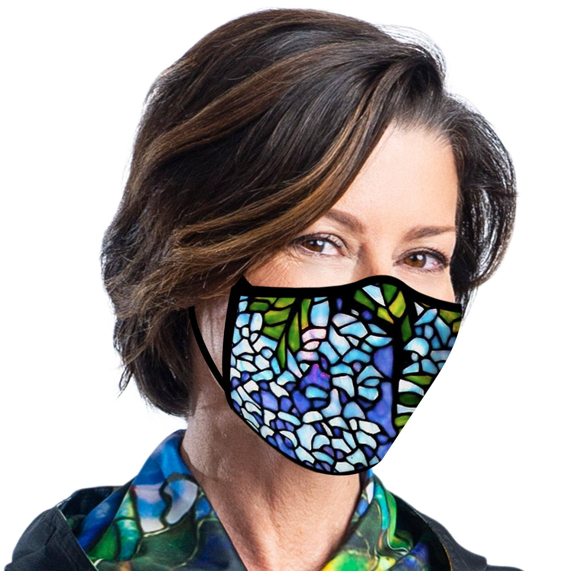 Woman wearing a RainCaper Tiffany Wisteria Reusable Fabric Face Mask.