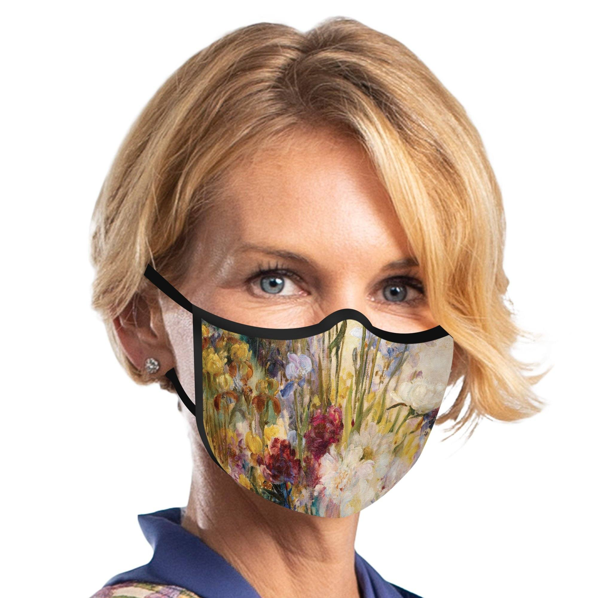 Woman wearing a RainCaper Tiffany Peonies and Iris Reusable Fabric Face Mask.