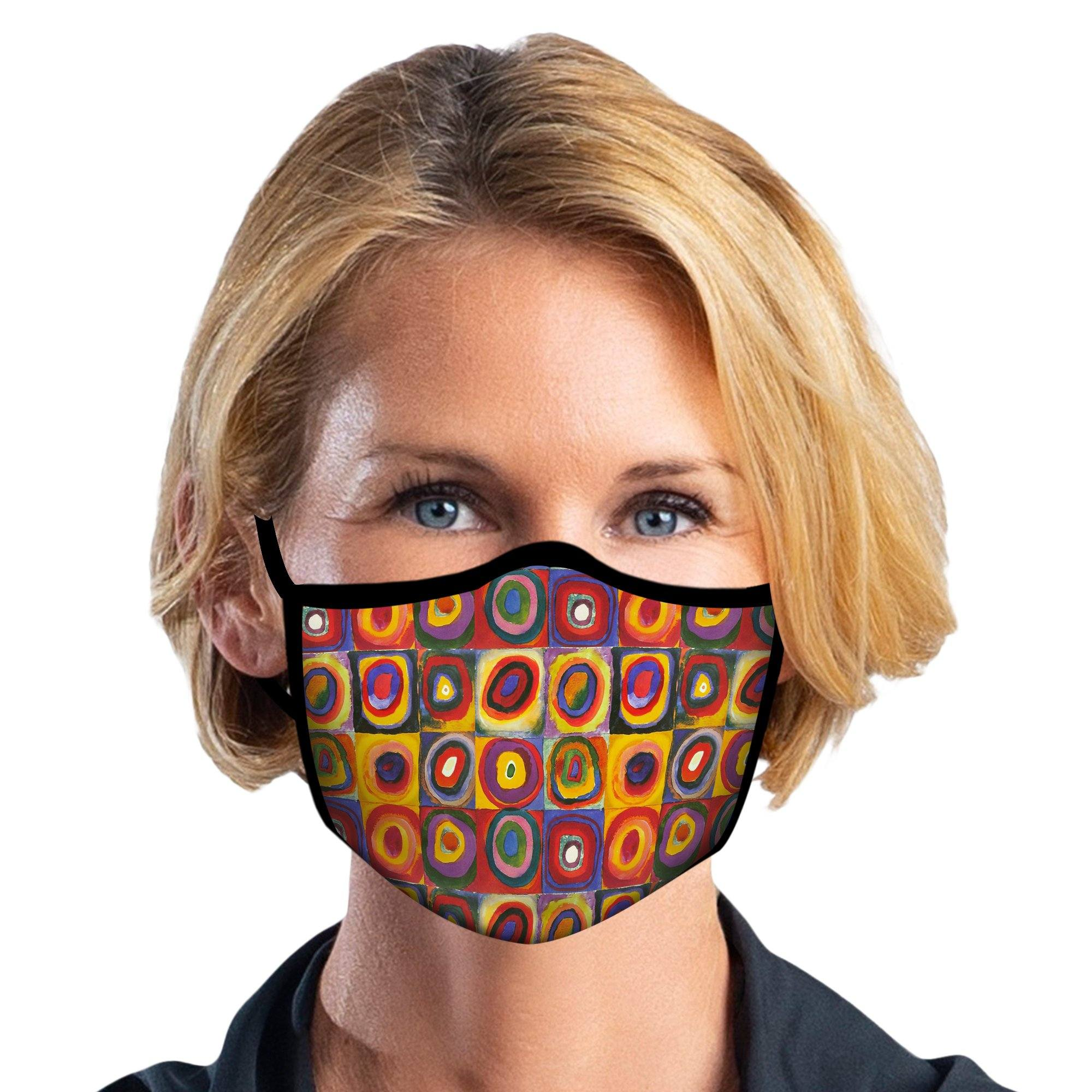 Woman wearing a RainCaper Kandinsky Circles reusable non-medical cloth face mask.