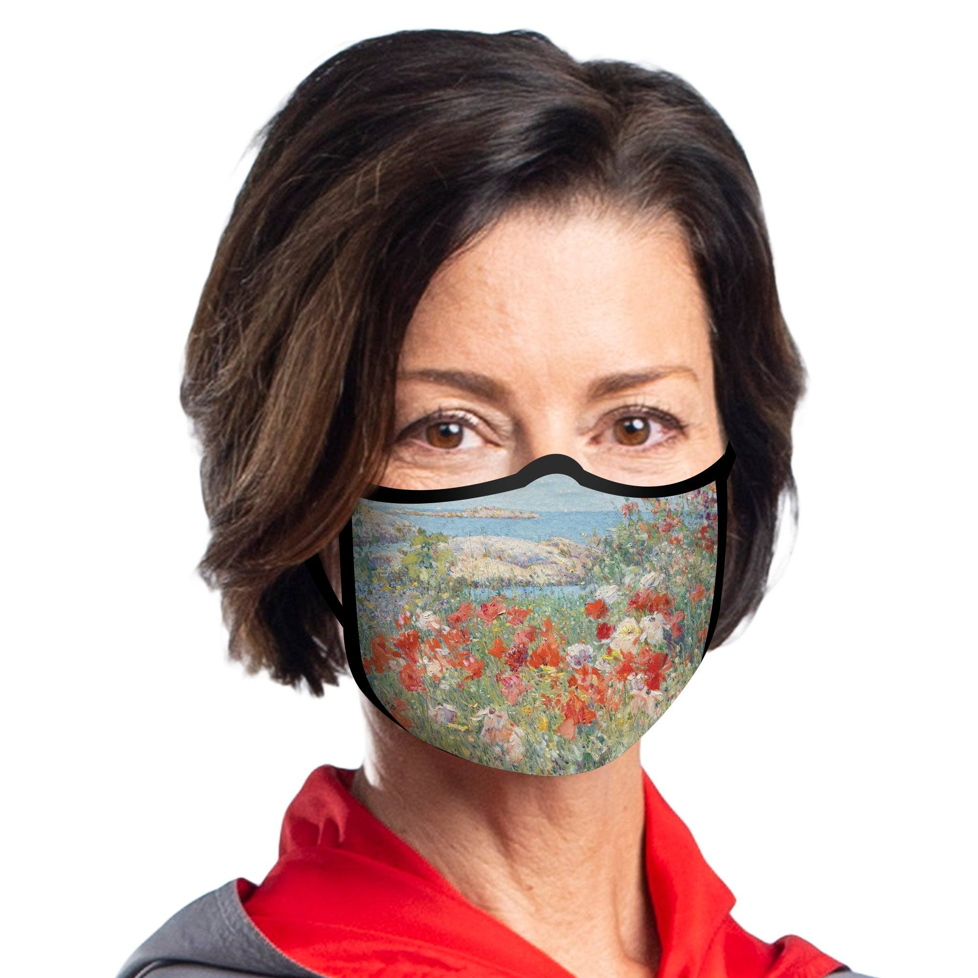 Woman wearing a RainCaper Hassam Celia's Garden/Isles of Shoals reusable non-medical cloth face mask.
