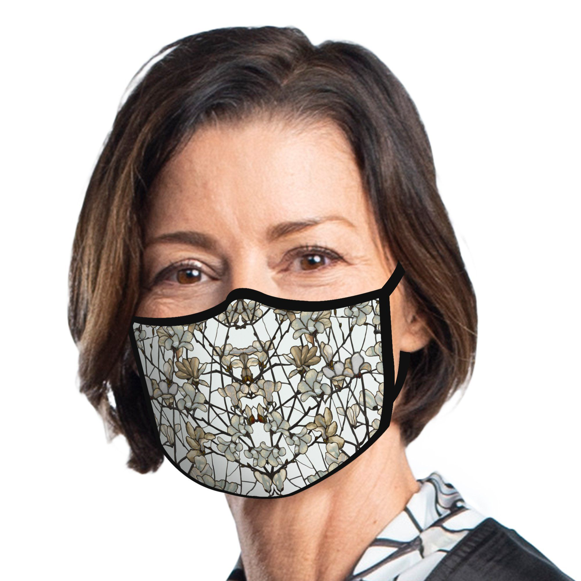 Woman wearing a RainCaper Tiffany Magnolia Reusable Fabric Face Mask.