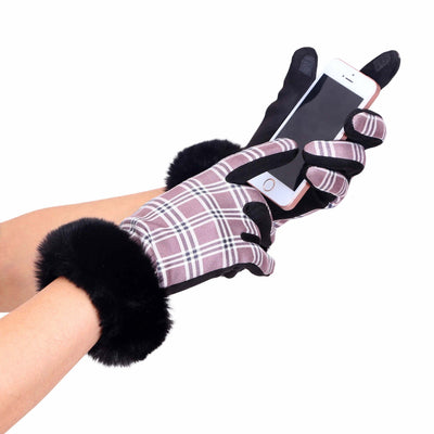 Woman's hands in pair of black, brown and white tartan plaid texting gloves with black fake fur cuffs; holding a cell phone and texting
