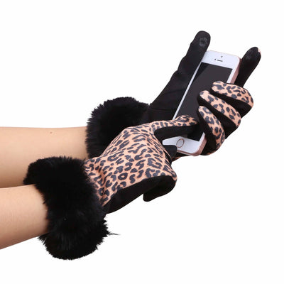 Woman's hands in pair of Black and Leopard print texting gloves with black fake fur cuffs; holding a cell phone and texting.