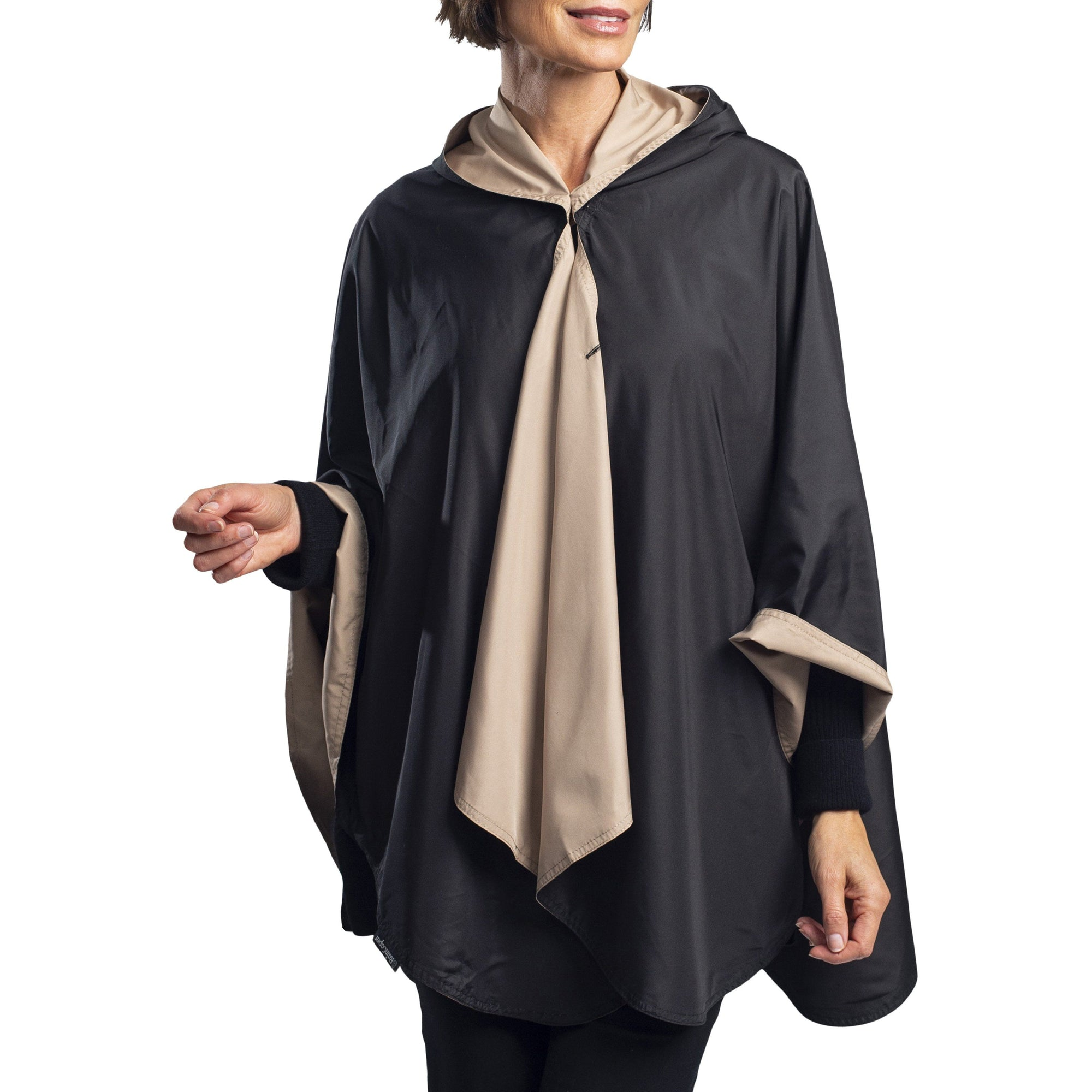 Women wearing a Black & Camel Reversible RainCaper travel cape with the Black side out, revealing the Camel color at the lapels and cuffs.