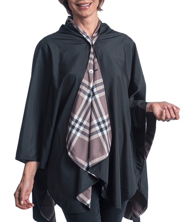 Women wearing a Black & Coco Plaid RainCaper travel cape with the Black side out, revealing the Coco Plaid print at the lapels and neck