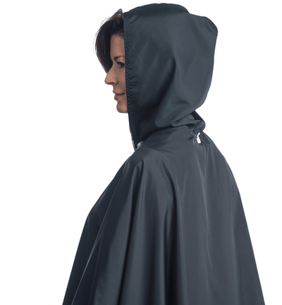 Women wearing a hooded Black & Coco Plaid RainCaper travel cape with the Black side out