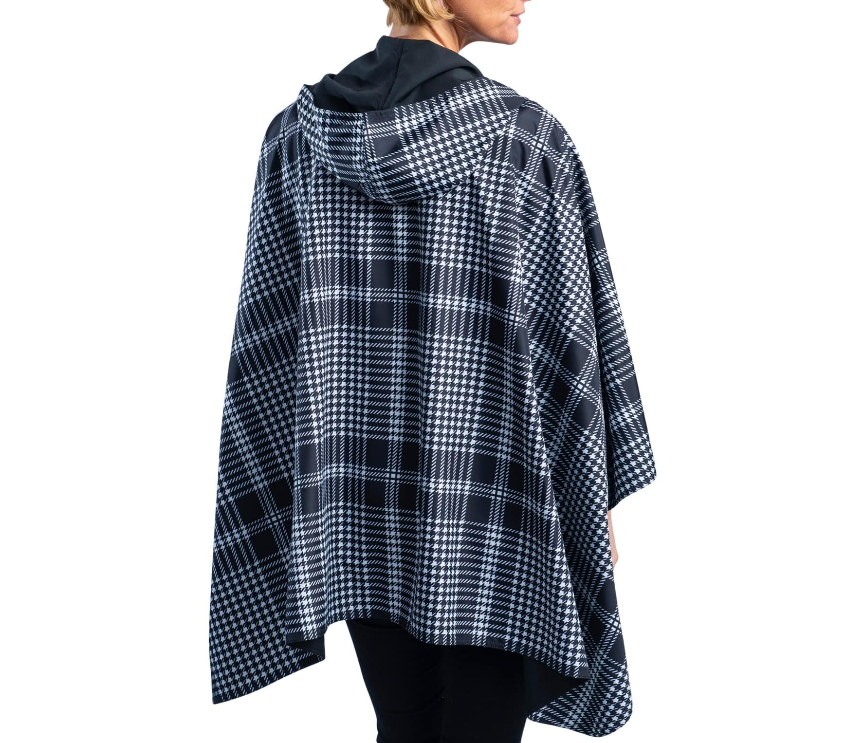 Women wearing a Black & White Houndstooth Plaid RainCaper travel cape with the Black side out, revealing the White Houndstooth Plaid print at the lapels and cuffs