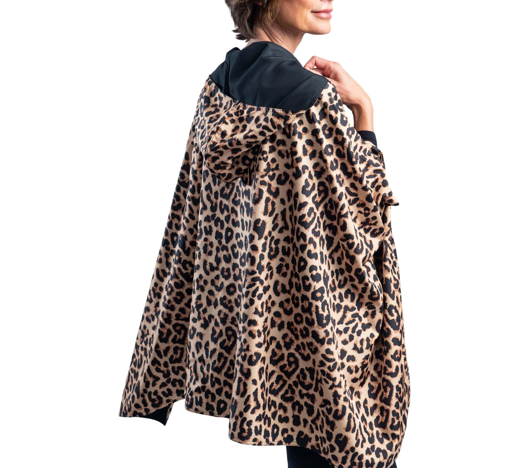 Women wearing a Black and Leopard Animal Print RainCaper travel cape with the Aqua side out, revealing the Leopard Animal print at the lapels and cuffs