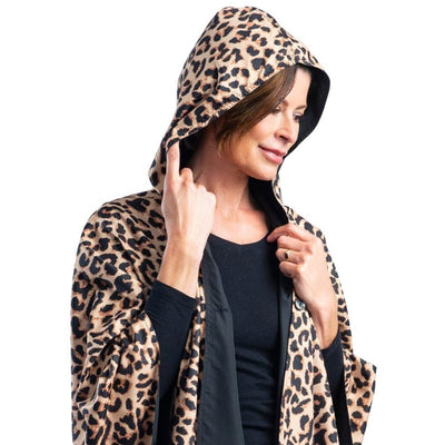 Women wearing a Black & Leopard Animal Print RainCaper travel cape with the Leopard Animal print side out