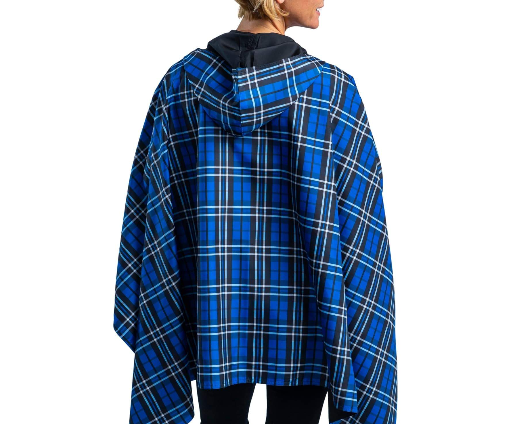 Women wearing a Black & Royal Tartan RainCaper travel cape with the Black side out, revealing the Royal Tartan print at the lapels and cuffs