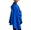 Women wearing a Black/Royal Blue RainCaper hooded travel cape with the Royal Blue side out