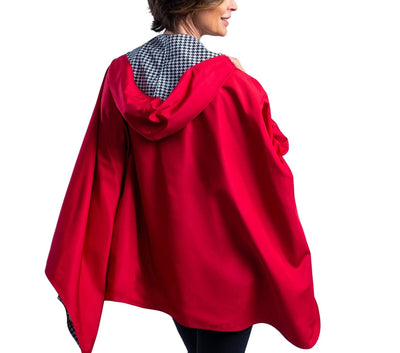 Women wearing a Crimson/Black & White Houndstooth RainCaper hooded travel cape with the Red side out