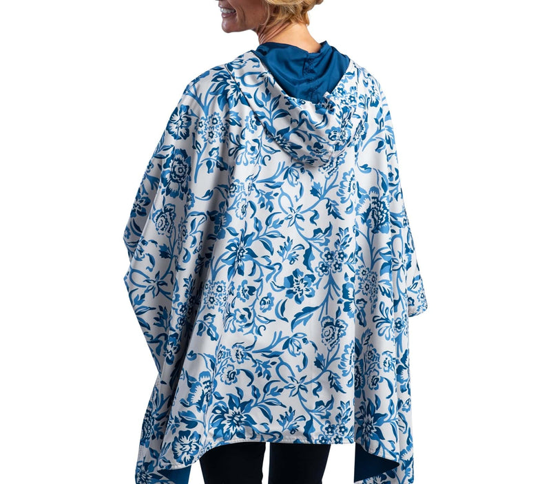Women wearing a Navy/Blue Garfield Print Wind RainCaper travel cape with the Navy side out, revealing the Blue Garfield Wind print at the lapels and cuffs