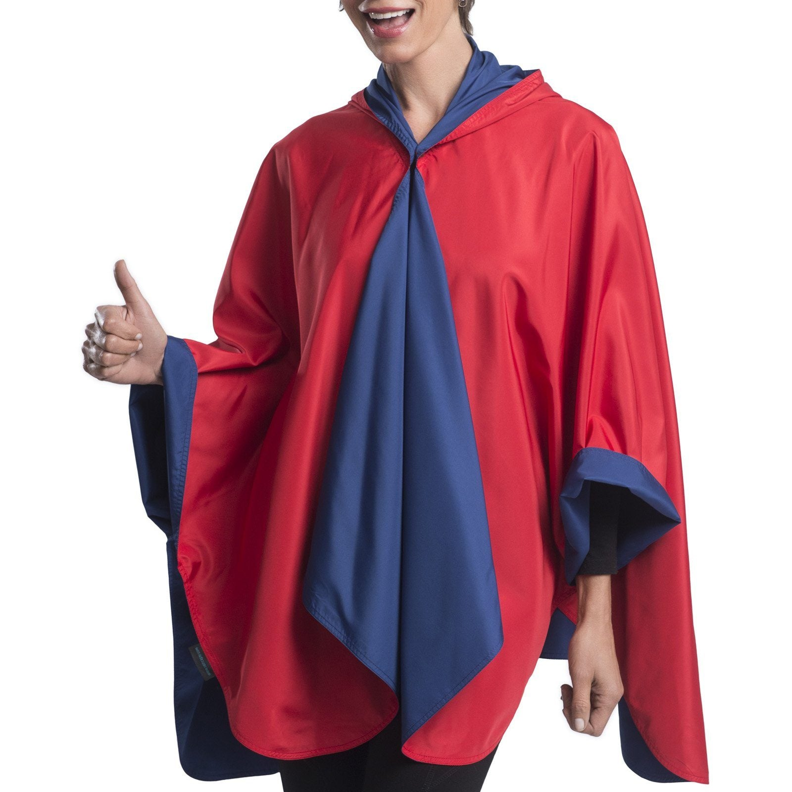 Woman wearing a Navy & Red Wind & Rainproof Sport Cape with the Navy side out, revealing the Red print at the lapels,neckline and cuffs