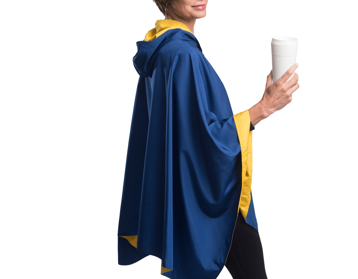 Woman wearing a Navy Blue & Gold Wind & Rainproof Sports Cape with the Navy Blue side out, revealing the Gold print at the lapels,neckline and cuffs