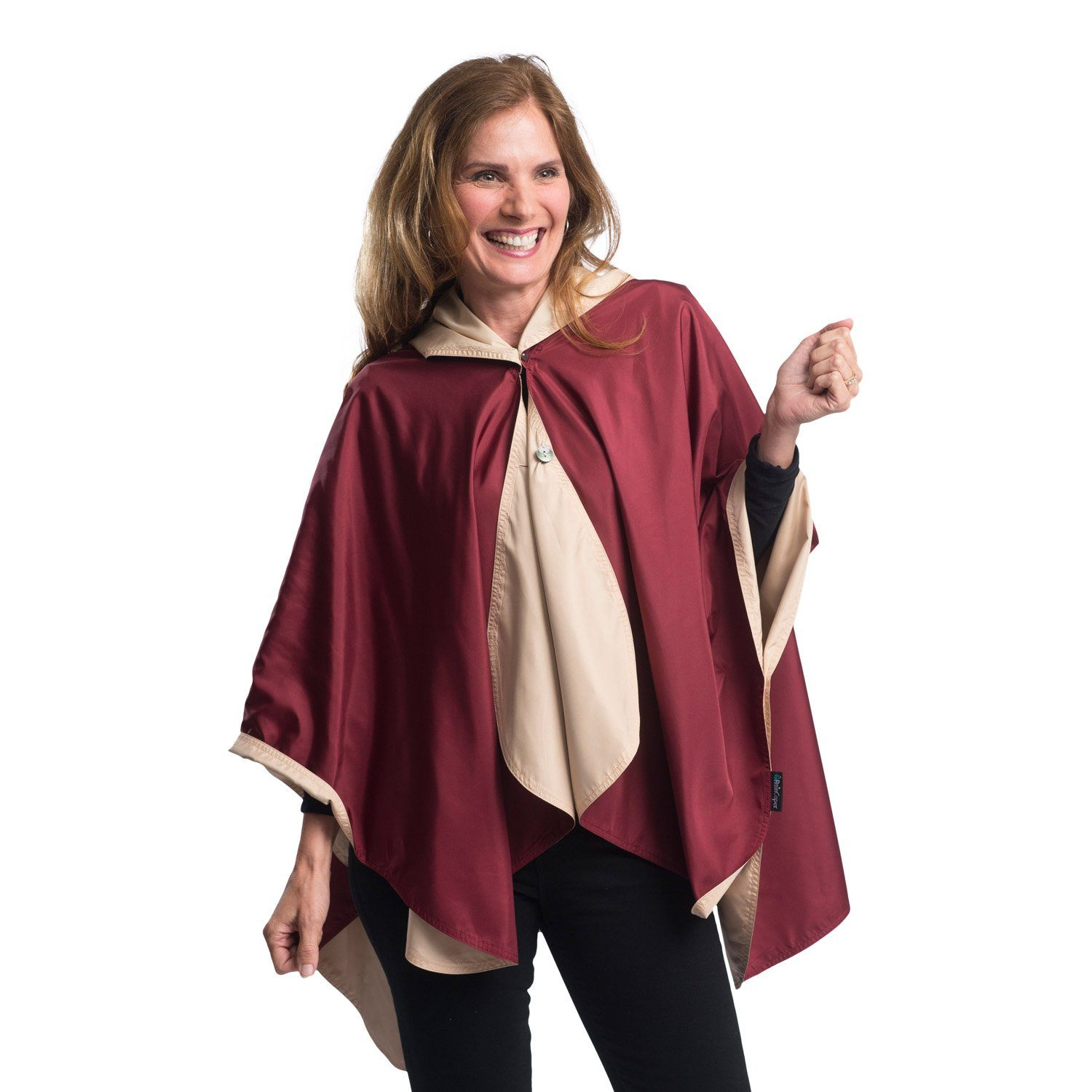 Woman wearing a Garnet & Gold Wind & Rainproof Cape with the Garnet side out, revealing the Gold print at the lapels,neckline and cuffs
