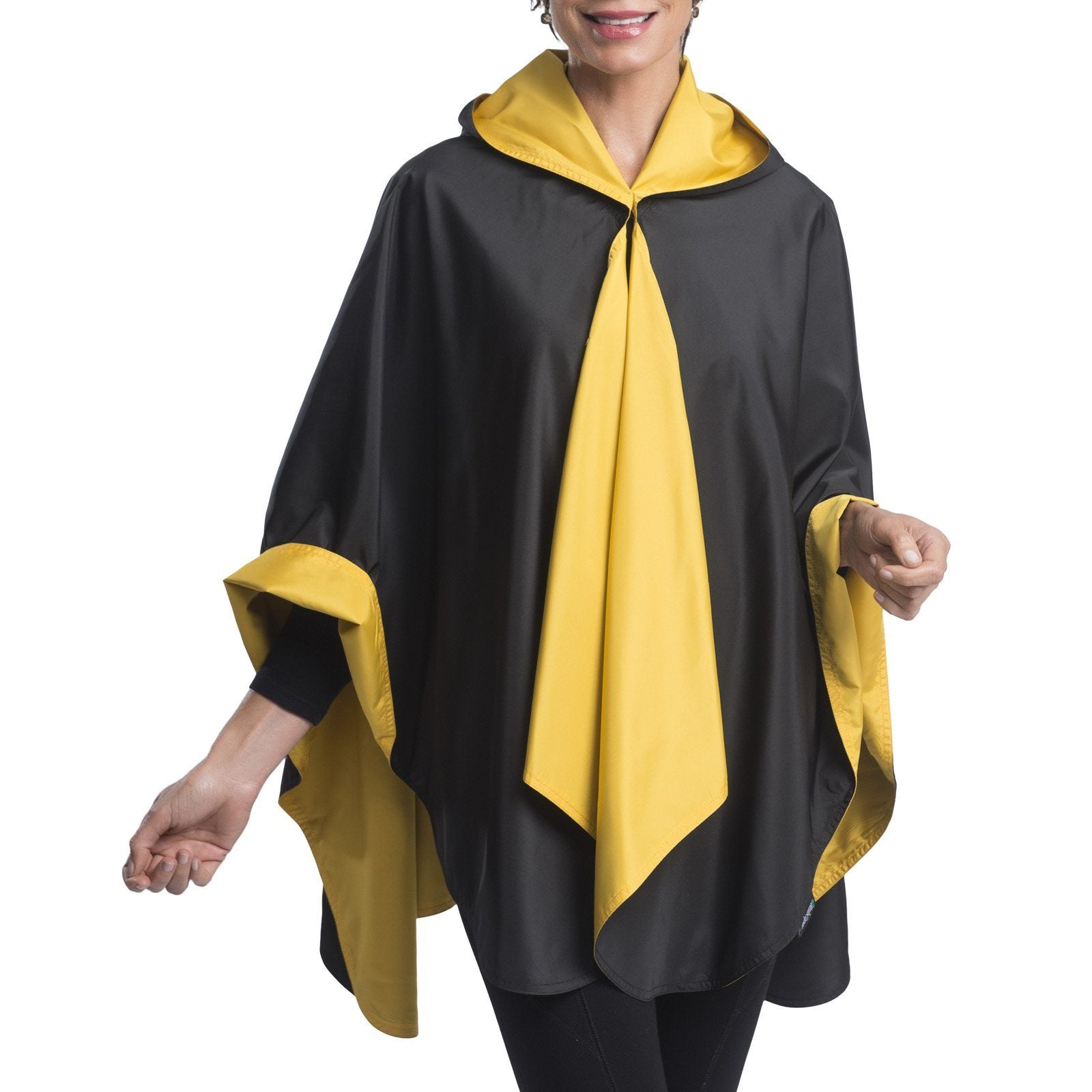 Woman wearing a Black & Gold Wind & Rainproof Cape with the Black side out, revealing the Gold print at the lapels,neckline and cuffs