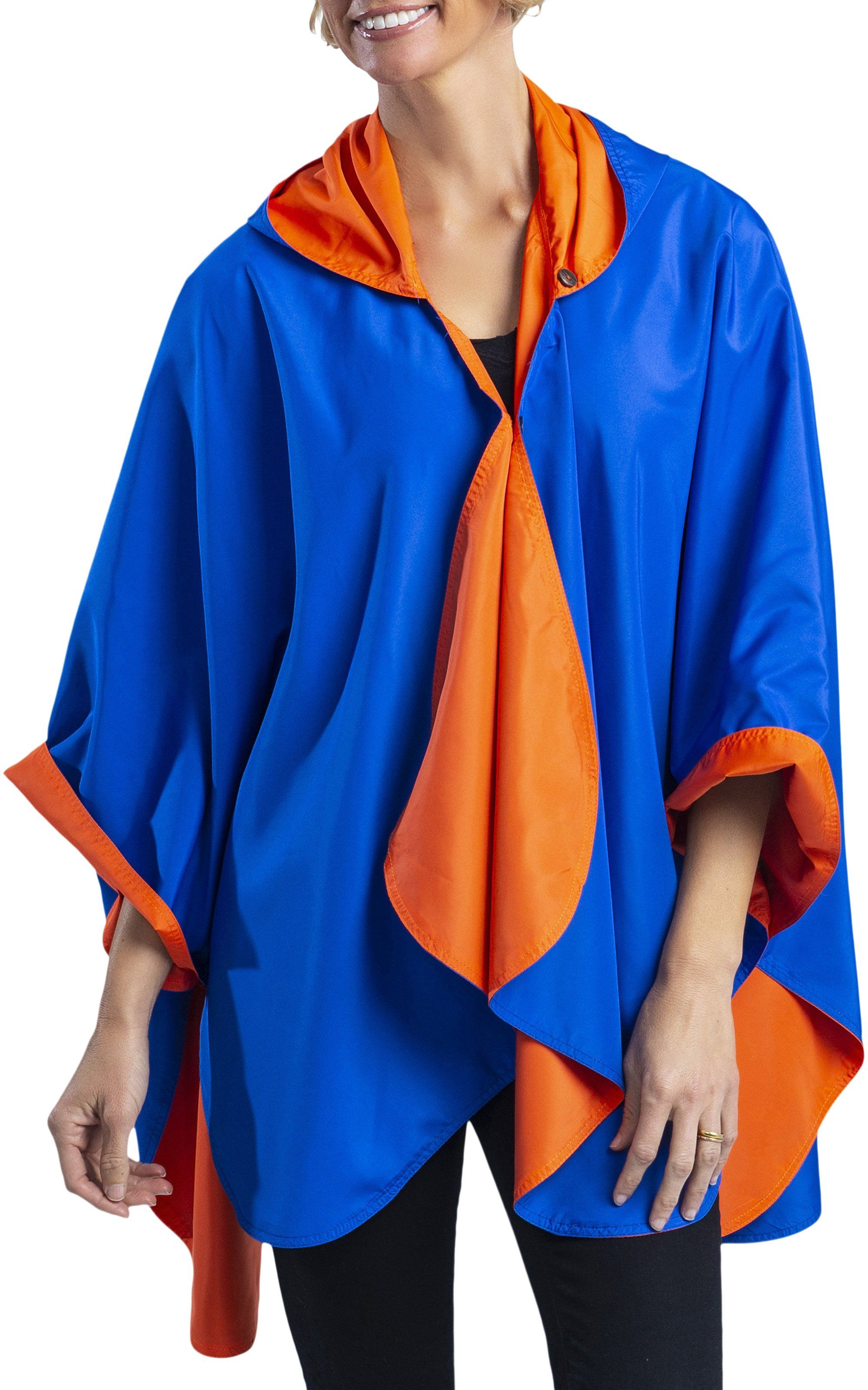 Woman wearing a Royal Blue & Orange Wind & Rainproof Cheer Cape with the Royal Blue side out, revealing the Orange print at the lapels,neckline and cuffs