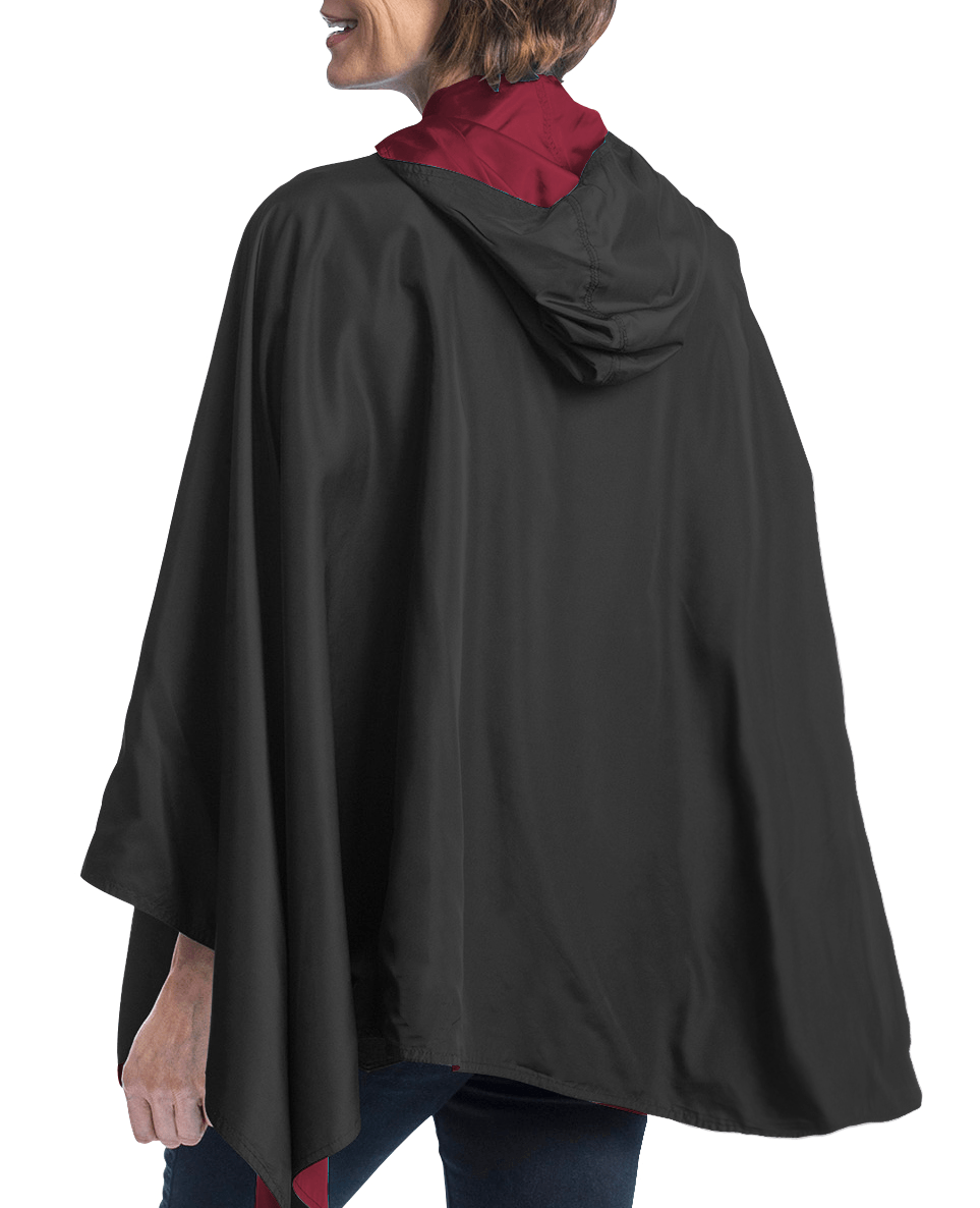 Woman wearing a Garnet & Black Wind & Rainproof Cape with the Garnet side out, revealing the Black print at the lapels  and cuffs