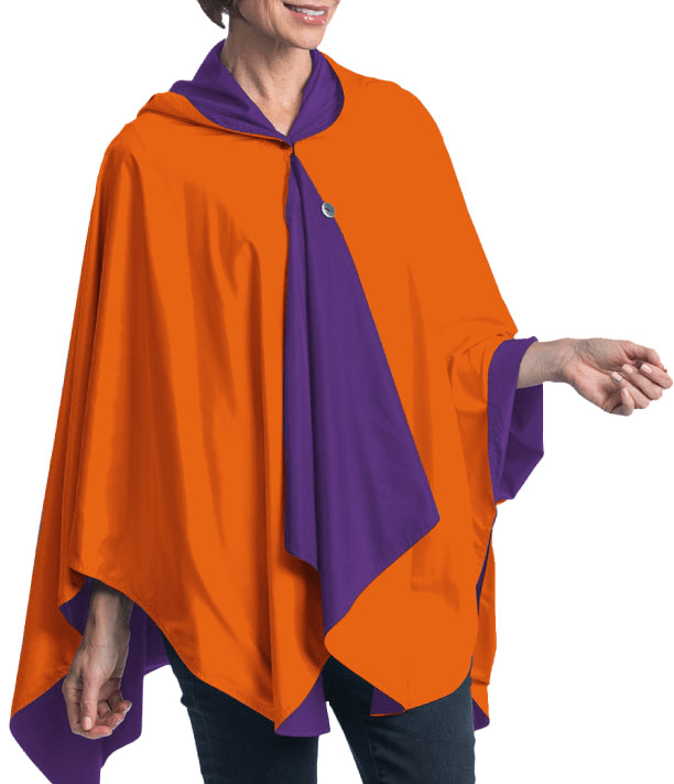 Woman wearing a Orange & Purple Wind & Rainproof Sport & Cheer Cape with the Orange side out, revealing the Purple print at the lapels,neckline and cuffs